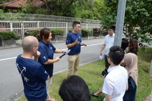 The tour group outside of Mr Lee's Oxley Road home where Mr Jason Loe, founder of Tribe, shares more on Mr Lee's frugality and Mr Lee as the family man.