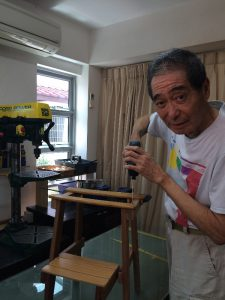Hai Sin in his workshop at home.