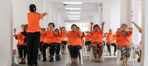 Elderly residents are encouraged to join a weekly group exercise class to keep active.