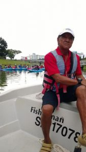 Francis taking a small breather from dragon boating.