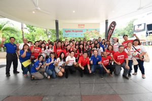 A group shot of the Young NTUC volunteers and union leaders with Mr Chan Chun Sing, Secretary-General of National Trade Union Congress (middle in red) and Mr Desmond Choo, Executive Secretary, Young NTUC (middle in white).