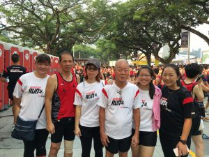 Kim Puay is joined with his family in the marathon.